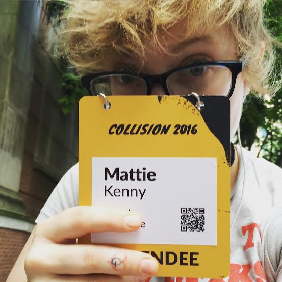 Mattie Kenny Holding Collision Conf Badge